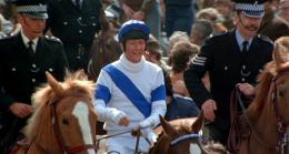 Mounted police escort Bob and Aldaniti to the winner's enclosure after the race