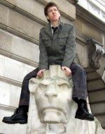 Ciaran Brown on 'Oscar' the right hand lion outside Nottingham's Council House