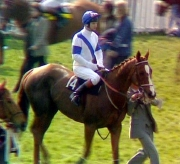 Bob Champion on Aldaniti in the parade ring before the start of the 1981 Grand National