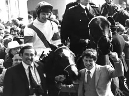 Nick Embiricos and Peter Double lead Aldaniti & Bob Champion into the winner's enclosure at Aintree