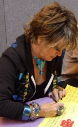 Amanda Barrie signing 'Carry On' poster