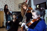 Nicola Benedetti visits young violinsts at their home as part of the 'Big Noise' project