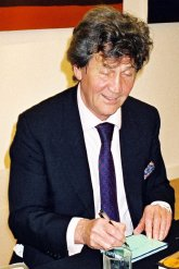 Melvyn Bragg signing autograph book