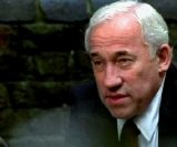 Simon Callow as St John in 'Surveillance'
