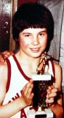 Joe Calzaghe aged 10 with a boxing trophy he won at Pentwynmawr Primary School