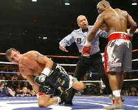 Joe Calzaghe is floored by Bernard Hopkins in 2008