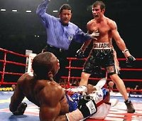 Joe Calzaghe floors Jeff Lacy in Round 12 of their fight in 2006