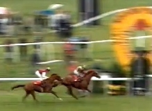 Willie Carson winning the 1988 St Leger on his homebred horse Minster Son, with the favourite Diminuendo in second place