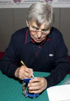 Willie Carson signing a Royal Doulton 'Willie Carson' character jug