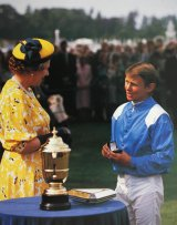 The Queen chats with Willie Carson