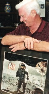 Gene Cernan with a signed picture of him on the moon