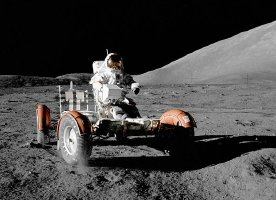 Gene Cernan drives the lunar rover across the moon's surface