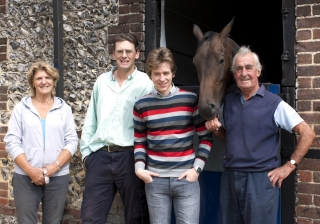 Ciaran Brown with Althea, Nick & Josh Gifford at Downs Stables in August 2011.  The horse is called Vinnie The Pooh.