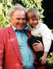 Five year old Ciaran Brown with Colin Baker
