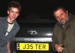 Ciaran Brown and Jethro by Jethro's Land Cruiser with its 'JESTER' number plate