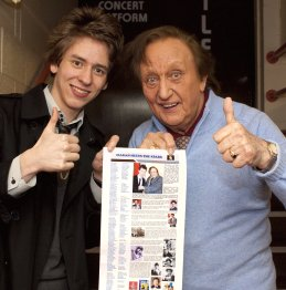 Ciaran Brown gives Ken Dodd a print out of his webpage after 'The Christmas Happiness Show' in Nottingham 2009