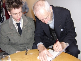 Ciaran Brown watches Alan Sillitoe signing his book