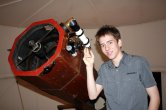 Ciaran brown with Sir Patrick Moore's 15 inch reflector telescope