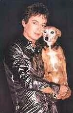 Julian Clary as The Joan Collins Fan Club, with Fanny the Wonderdog
