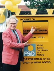 Colin Baker opens the FSID clothing bank in 1996