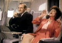 Joan Collins & Leonard Rossiter in one of their famous commercials for Cinzano