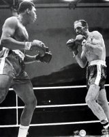 Henry Cooper in action against Cassius Clay (Muhammad Ali) in 1963