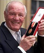 Sir Henry Cooper receives his Knighthood in 2000