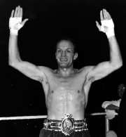 Henry Cooper wearing his Lonsdale Belt