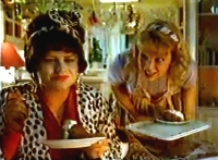 Sara Crowe & Ann Bryson in one of their famous commercials for Philadelphia cheese