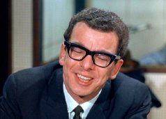 Barry Cryer as Roger the TV Director in 'Primitive London' (1965)