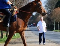 Richard Dunwoody walking along Newmarket's Bury Road during his '1000 miles in 1000 hours' challenge
