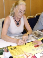 Shirley Eaton signing Carry On poster