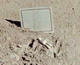 The small statuette and list of dead astronauts, as placed by Dave Scott on the Moon's surface.