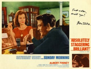 Alan Sillitoe has signed this lobby card showing Shirley Anne Field and Albert Finney in 'Saturday Night and Sunday Morning'