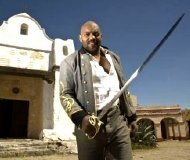 Ken Foree as the Barman in the film short 'Dead Bones' (2008)