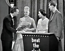 Bruce Forsyth with contestants in 'Beat the Clock'