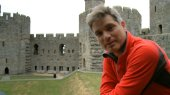 Jonathan Foyle at Caernarvon Castle in 'Climbing Great Buildings'
