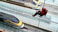 Jonathan Foyle abseils down to the platforms of St Pancras Station in 'Climbing Great Buildings'
