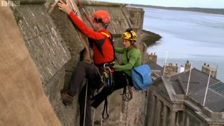 Jonathan Foyle and Lucy Creamer on the walls of Caernarvon Castle in 'Climbing Great Buildings'