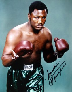 Joe Frazier signed this photograph at the NEC in Birmingham