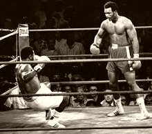 Joe Frazier is knocked to the floor by George Foreman in 1973