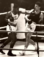 Joe Frazier fighting Huber during the 1964 Olympics