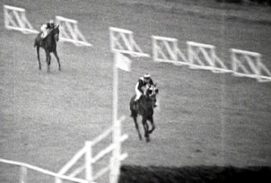 Josh Gifford on Honey End chases eventual winner Foinavon to the last fence in the 1967 Grand National