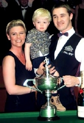 Stephen Hendry with his wife Mandy, and son Blaine, after defeating Mark Williams in the World Championship final in 1999