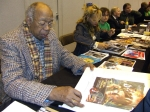 Geoffrey Holder signing Jeff Marshall lithograph