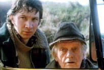 Richard Hope as Hubert and Bill Owen as Amos in the film 'Singleton's Pluck' (1985)