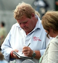 Geoffrey Hughes signs an autograph for a fan at the Fairport Copredy Convention