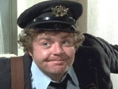 Geoffrey Hughes as The Postman in 'Confessions of a Driving Instructor' (1976)
