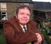 Geoffrey Hughes as Vernon Scripps in 'Heartbeat'