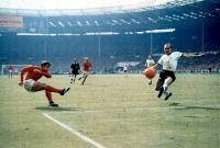 Geoff Hurst scoring England's controversial 3rd goal in the World Cup final